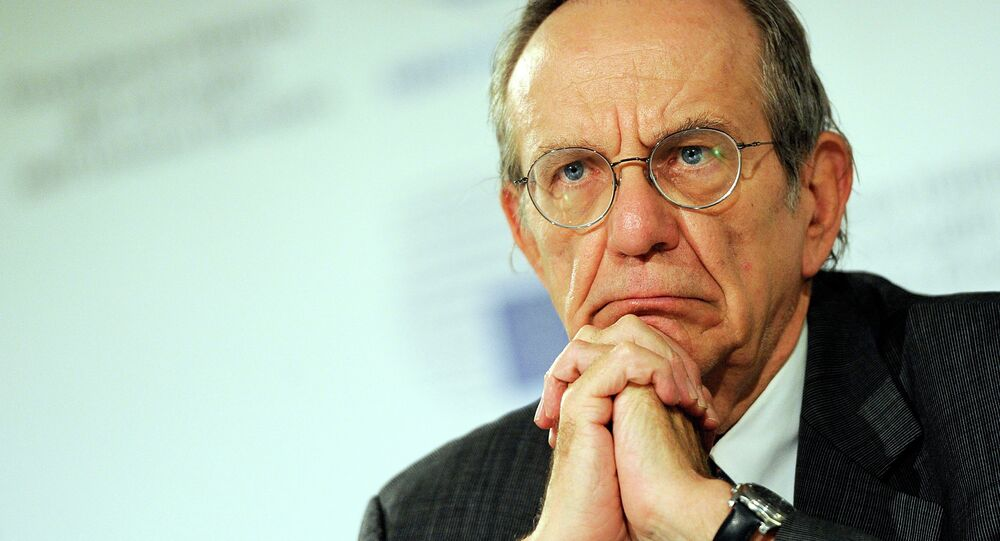 Italian Finance Minister Pier Carlo Padoan attends a meeting in Milan, Italy, Saturday, Sept. 13, 2014