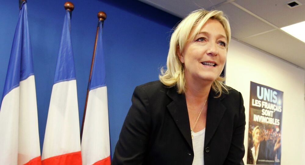 France's National Front political party head Marine Le Pen arrives to attend a news conference at the party headquarters in Nanterre near Paris February 6, 2015