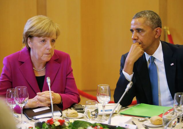 President Obama and Chancellor Merkel seated together at a G7 dinner in Brussels.