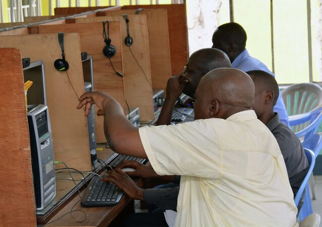 Local residents use computers at an internet cafe in Kinshasa.