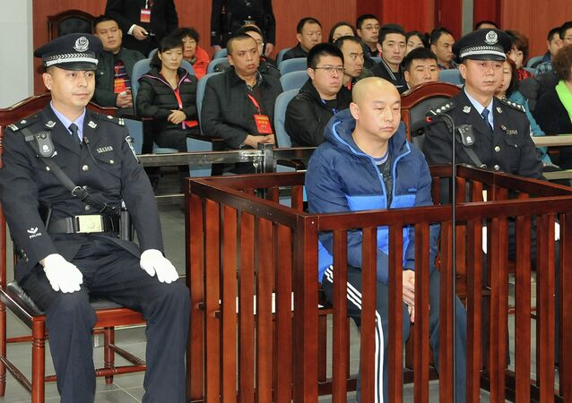 Zhao Zhihong (C), a man who confessed to murdering a woman in China 18 years ago.