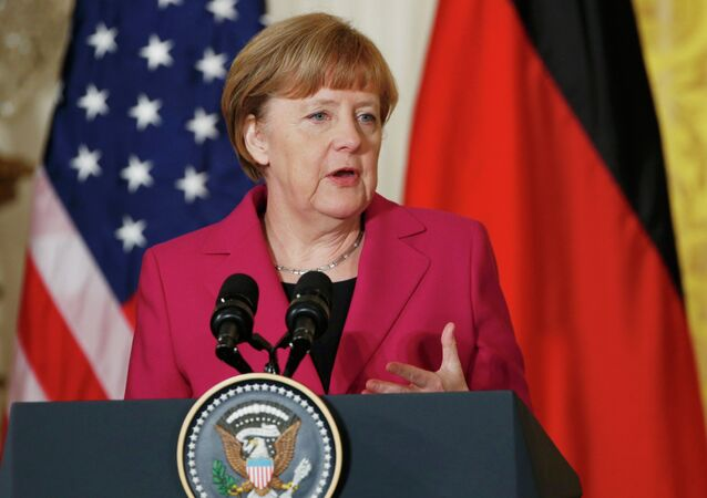 German Chancellor Angela Merkel speaks as she holds a joint news conference with U.S. President Barack Obama in the East Room of the White House in Washington February 9, 2015
