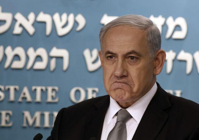Israeli Prime Minister Benjamin Netanyahu gestures during a press conference in Jerusalem, Tuesday Dec. 2, 2014.