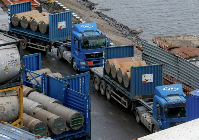 Trucks carrying containers with uranium to be used as fuel for nuclear reactors line up for loading them, on a port in St. Petersburg, Russia, Thursday, Nov. 14, 2013