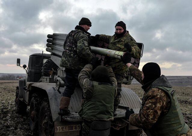 Ukrainian servicemen load Grad rockets outside Debaltseve, eastern Ukraine February 8, 2015