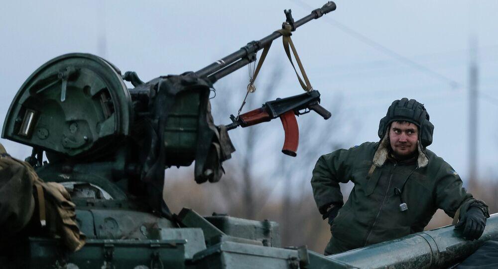 A Ukrainian serviceman stands on a tank near Artemivsk, eastern Ukraine, February 8, 2015
