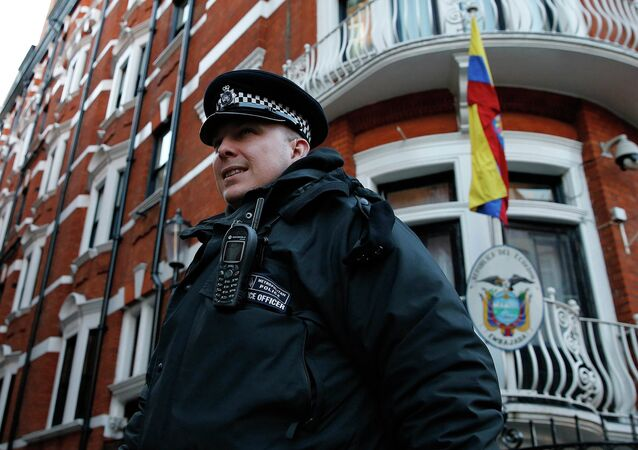 A police officer walks past the Ecuador embassy following a shift change in London February 6, 2015
