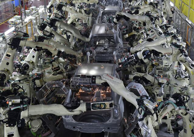 A general view shows the body welding workshop which uses automated welding machine robots that assemble automobile bodies called white body (body before painting) at Toyota Motor's Tsutsumi plant in Toyota, Aichi prefecture on December 4, 2014