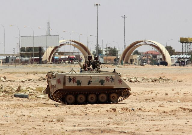 Jordanian soldiers on a tank secure the area near the Al-Karameh border point with Iraq on June 25, 2014