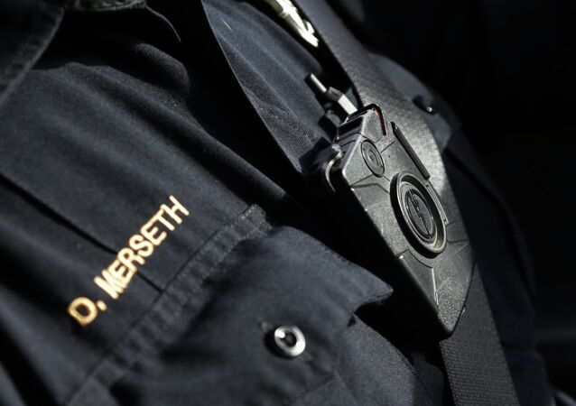 In this Feb. 2, 2015 photo, police officer Dan Merseth wears one of Duluth, Minnesota's 110 officer-worn cameras. Demand for the devices is booming after last summer's unrest in Ferguson, Mo., and cities are already wrestling with whether they can afford to equip all their officers and how often the cameras should be turned off to reduce the video recorded.