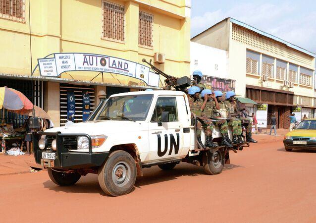 UN peacekeeping soldiers from Rwanda patrol on December 09, 2014 in Bangui