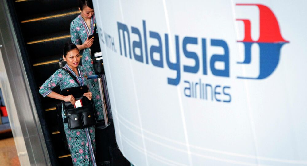 Air stewardess was sacked for being one pound 'overweight' with Malaysia Airlines