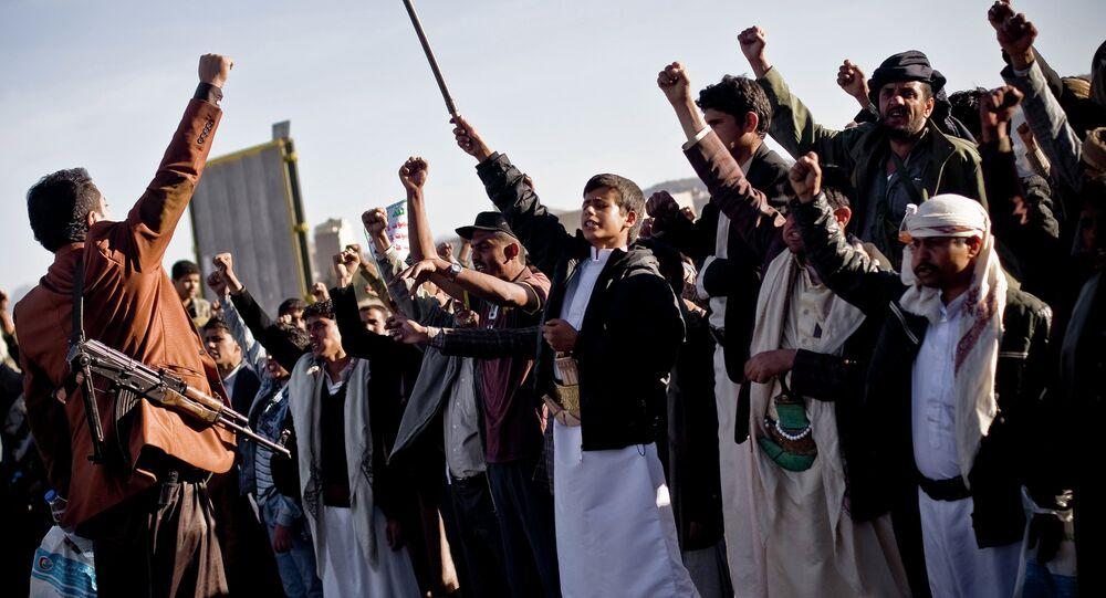 Houthi Shiite Yemenis chant slogans during a rally in Sanaa, Yemen, Wednesday, January 28, 2015.