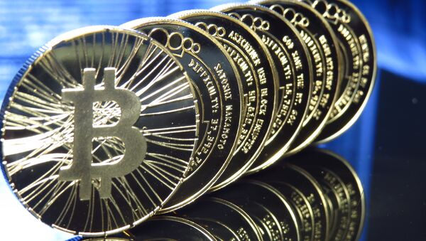 Bitcoin is a decentralized form of digital currency, created and held online all over the world. The cryptocurrency is used to buy things electronically. - Sputnik International