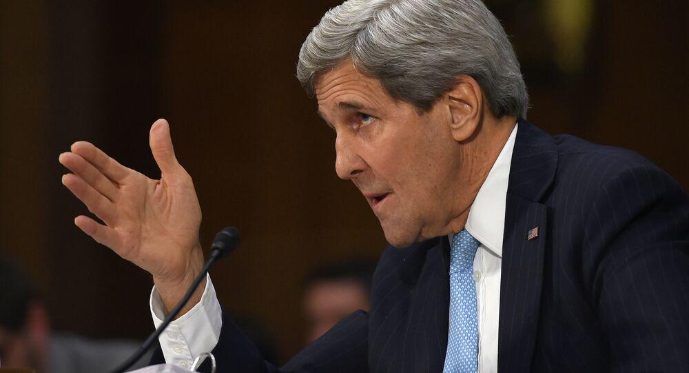 Secretary of State John Kerry testifies on Capitol Hill in Washington, Tuesday, Dec. 9, 2014
