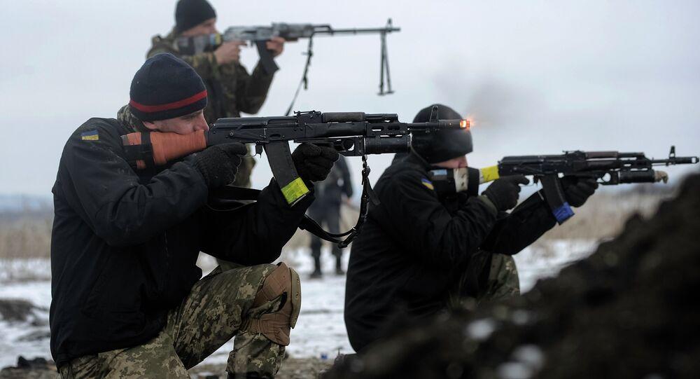 Ukrainian servicemen train with weapons