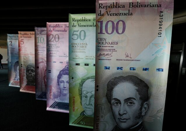 Samples of Venezuela's currencies are displayed at the Central Bank building in Caracas