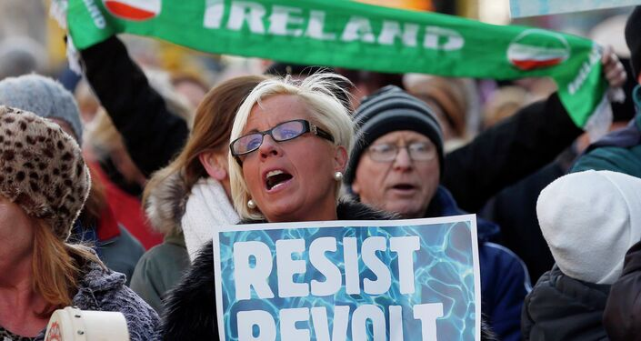 People gather to protest against austerity policies and increases in water bills, according to local media, in central Dublin January 31, 2015.