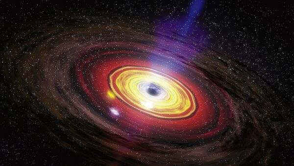 Supermassive black holes, the largest type of black hole, are usually found at the center of large galaxies.  - Sputnik International