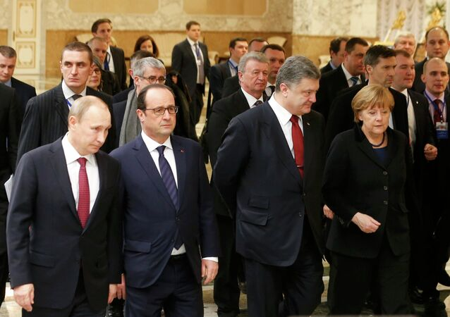 Russia's President Vladimir Putin (L, front), Ukraine's President Petro Poroshenko (2nd R, front), Germany's Chancellor Angela Merkel (R, front) and France's President Francois Hollande (2nd L, front) walk during peace talks in Minsk