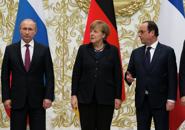 From the left : Russian President Vladimir Putin, German Chancellor Angela Merkel, French President Francois Hollande, and Ukrainian President Petro Poroshenko pose for a photo during a time-break in their peace talks in Minsk, Belarus