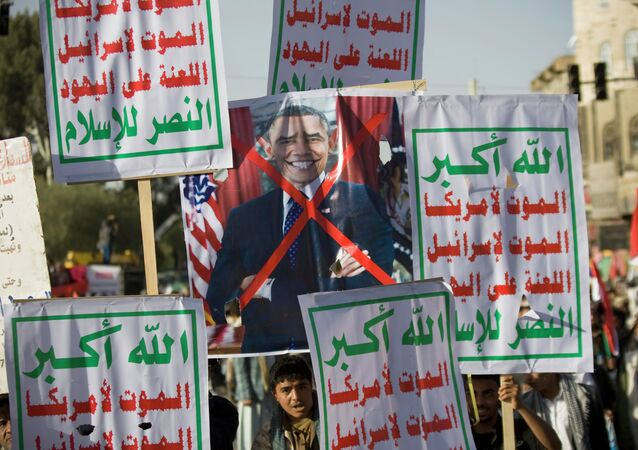 Houthi Shiite Yemenis hold a poster of US President Barack Obama.