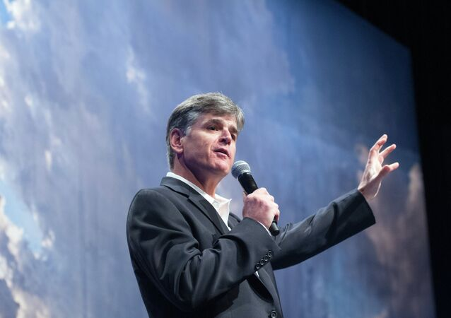 Political commentator Sean Hannity addresses the crowd while delivering his speech, Get America Back to Work, Thursday, May 22, 2014, during the 22nd Williston Basin Petroleum Conference held in Bismarck, N.D.