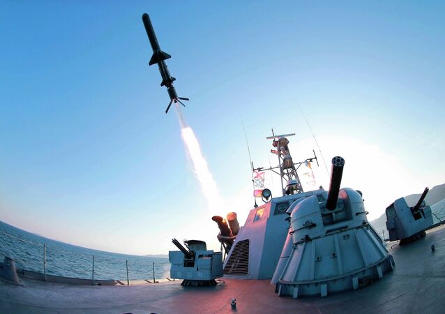A missile is fired from a naval vessel during the test-firing of a new type of anti-ship cruise missile to be equipped at Korean People's Army (KPA) naval units.