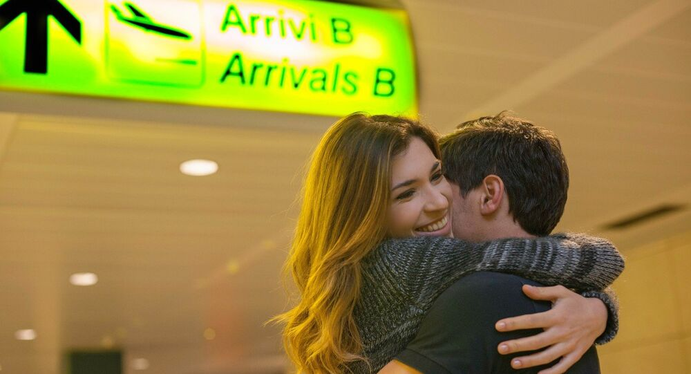 A couple at an airport terminal