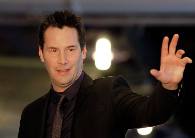 Actor Keanu Reeves waves to his fans during the red carpet event for his new movie John Wick in Seoul, South Korea, Thursday, Jan. 8, 2015. The movie is to be released in South Korea on Jan. 21.