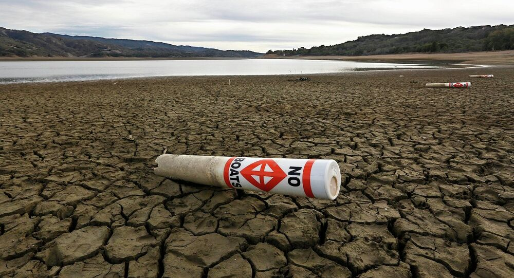 In this Feb. 4 2014 file photo, a warning buoy sits on the dry, cracked bed of Lake Mendocino near Ukiah, Calif. As bad as the drought in California and the Southwest was last year and in the Midwest a couple years ago, scientists say far worse historic decades-long dry spells are coming. ""
