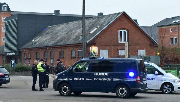Emergency services gather outside a venue after shots were fired where an event titled Art, blasphemy and the freedom of expression was being held in Copenhagen - Sputnik International