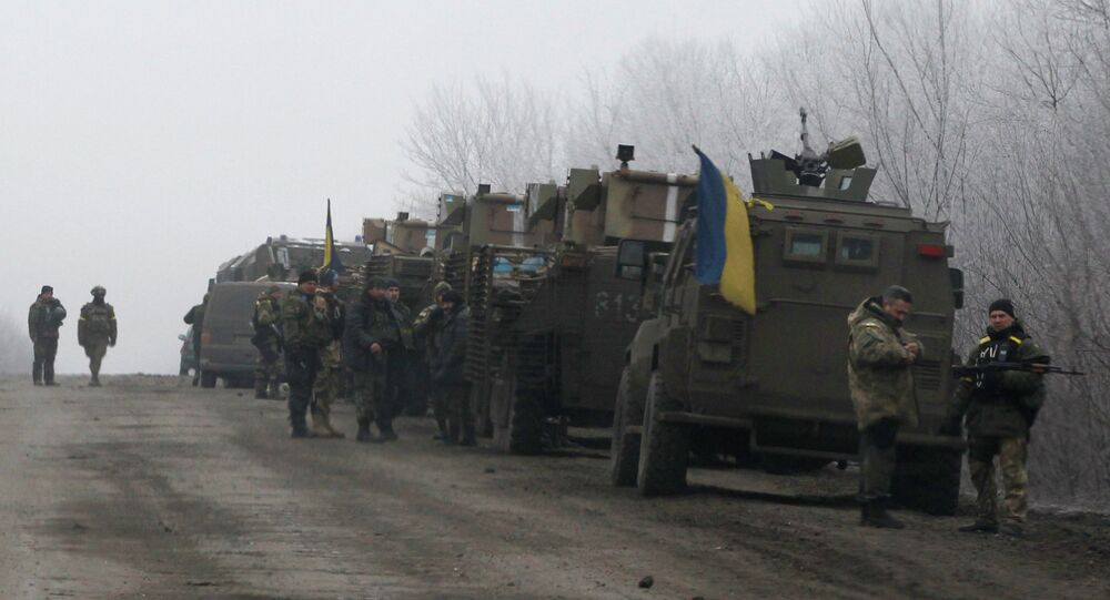 Ukrainian military convoy stop on the road between the towns of Debaltseve and Artemivsk, Ukraine, Saturday, Feb. 14, 2015
