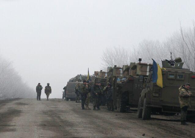 Ukrainian military convoy stop on the road between the towns of Debaltseve and Artemivsk, Ukraine, Saturday, Feb. 14, 2015