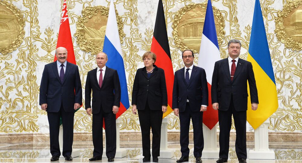 Group photo at Independence Palace in Minsk after restricted attendance peace talks on Ukraine held by Russian, German, French and Ukrainian leaders, February 11, 2015