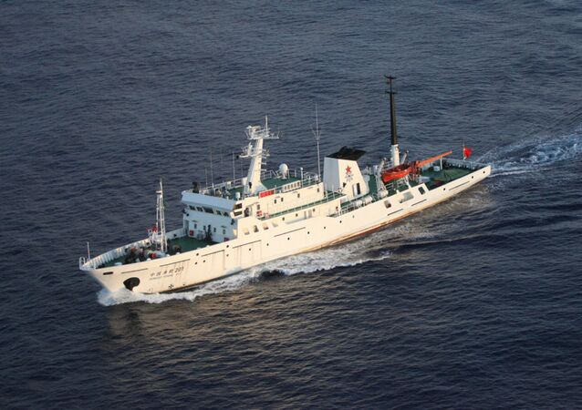 In this photo released by Japan Maritime Safety Agency, a Chinese vessel sails in waters off the disputed islands known as Senkaku in Japan and Diaoyu in China in the East China Sea Wednesday, Aug. 24, 2011