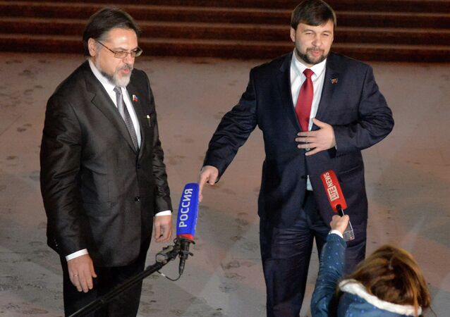 Representatives of the Donetsk and Lugansk people's republics Denis Pushilin and Vladislav Deinego (from right to left)