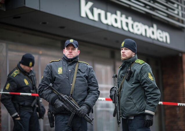 Police guard the scene of a shooting at cafe 'Krudttonden,' which was hosting a free speech event, in Oesterbro, Copenhagen, February 16, 2015