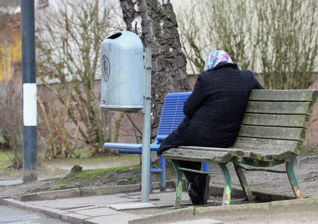 A woman refugee sits on a bench in the Marienfelde Refugee Transit Center in South Berlin, on January 29, 2015