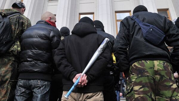 Supporters of the right wing party Pravyi Sector (Right Sector) protest in front of the Ukrainian Parliament in Kiev on March 28, 2014 - Sputnik International