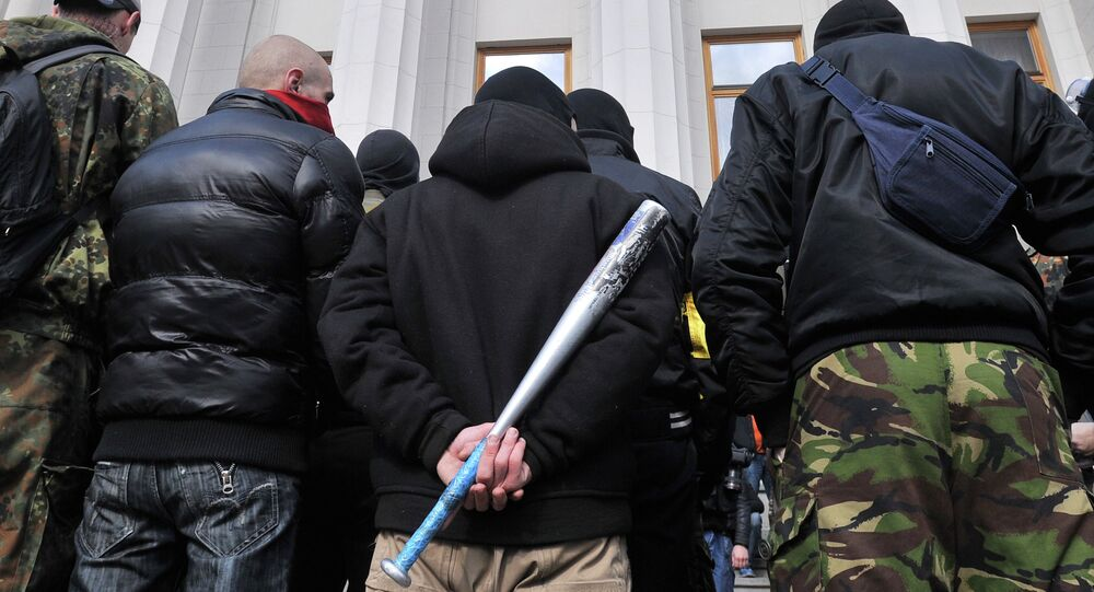 Supporters of the right wing party Pravyi Sector (Right Sector) protest in front of the Ukrainian Parliament in Kiev on March 28, 2014