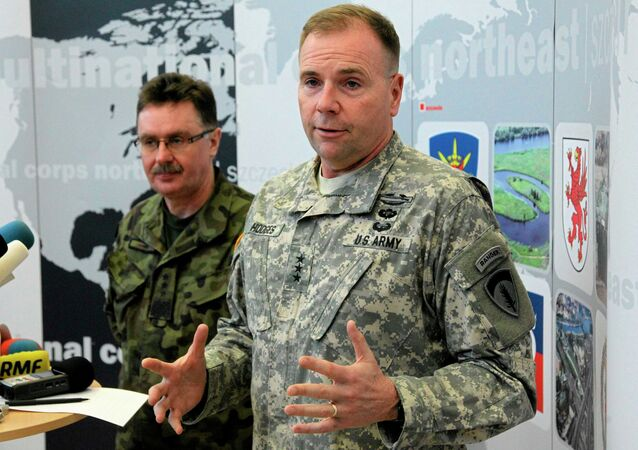 U.S. Army Europe commander Ben Hodges speaks as Polish general Boguslaw Samol stands during news conference during a visit to the Multinational Corps Northeast, NATO base at Szczecin in north-west Poland February 11, 2015
