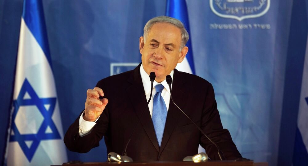 Israel's Prime Minister Benjamin Netanyahu speaks during a handover ceremony at the prime minister's office in Jerusalem, in which the new Chief of Staff Lieutenant-General Gadi Eizenkot replaced outgoing Chief of Staff Lieutenant-General Benny Gantz, February 16, 2015