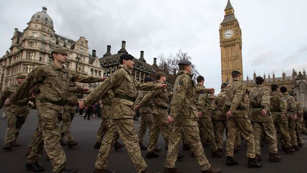 Members of Britain's armed forces march from Wellington Barracks to The Houses of Parliament during the final March Into Parliament for Operation Herrick in London January 26, 2015 - Sputnik International