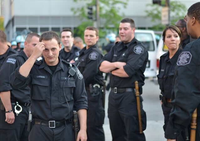 Chicago police officers watching over a 2012 anti-NATO protest march