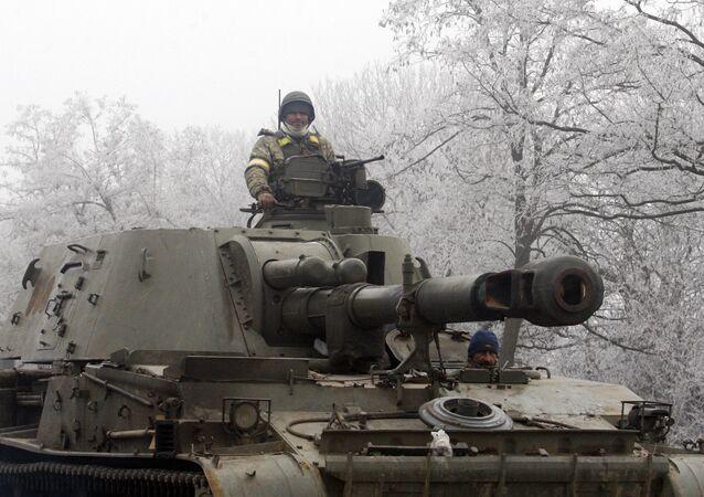 Ukrainian servicemen patrol with a self-propelled artillery gun on the road between Artemivsk and Debaltseve, in the region of Donetsk, on February 15, 2015