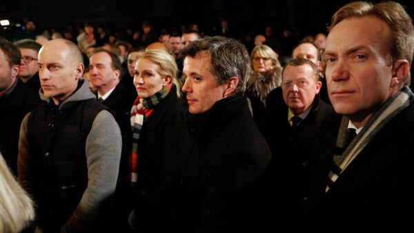 Danish Prime Minister Helle Thorning-Schmidt (3rd L), her husband Stephen Kinnock (L), Crown Prince Frederik (C), Liberal leader Lars Lokke Rasmussen (2nd R) and Norwegian Foreign Minister Borge Brende (R) stand together during a memorial service for victims of deadly attacks on a synagogue and an event promoting free speech, in Copenhagen February 16, 2015 - Sputnik International