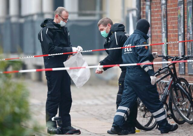 Danish police investigate the area where an unattended package was found in front of a cafe in Oesterbro, Copenhagen February 17, 2015