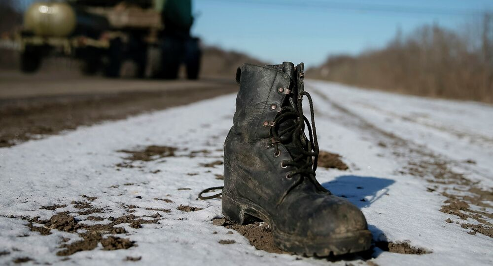 A military boot is seen at the road near Debaltseve, eastern Ukraine, February 17, 2015
