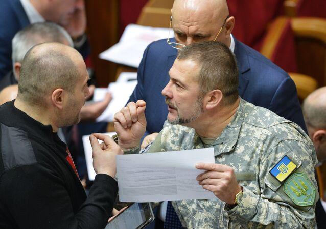From left: Borislav Bereza, chief spokesman for the Right Sector, and Yury Bereza, commander of the Dnepr battalion, attending Ukraine's Supreme Rada (Parliament) meeting